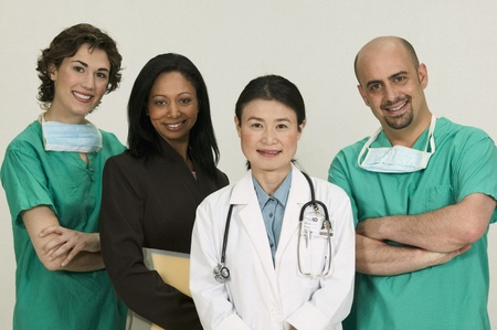Group of doctors looking at looking at camera smiling Stock Photo - 16044560