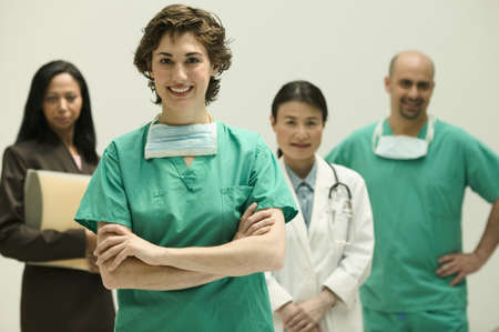 Group of doctors looking at camera smiling Stock Photo - 16044561