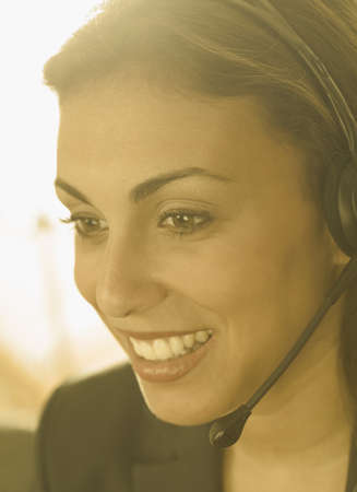 Young woman wearing a headset smiling Stock Photo - 16044603
