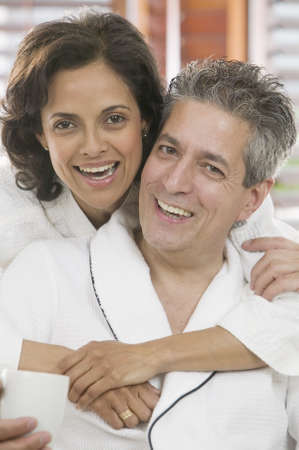 anecdote: Couple holding each other looking at camera