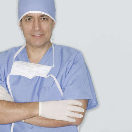Portrait of a male doctor in full scrubs looking at camera Banco de Imagens