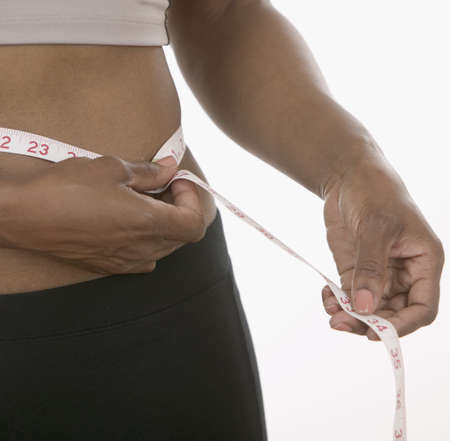 Person measuring waist with a measuring tape Stock Photo - 16044632