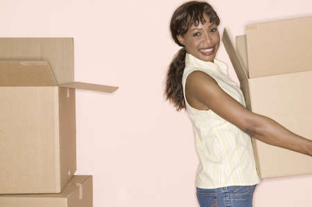 Woman carrying a cardboard box Stock Photo - 16044638