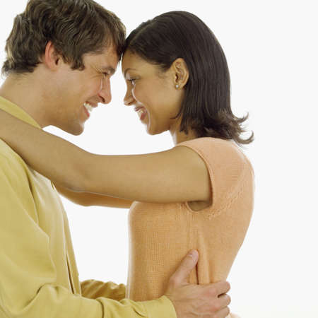 narrative: Young couple holding each other smiling