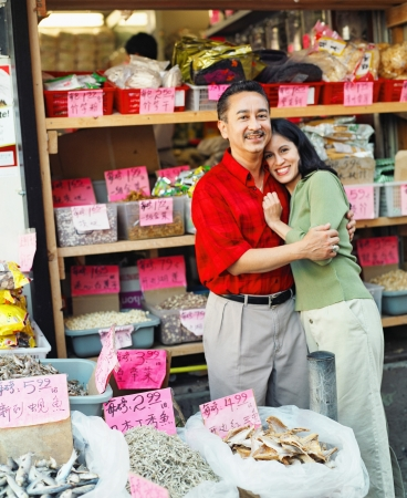 mid adult couple: Portrait of a mid adult couple in a shop LANG_EVOIMAGES