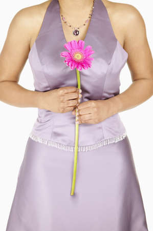 Torso of a young woman holding a flower Stock Photo - 16044709