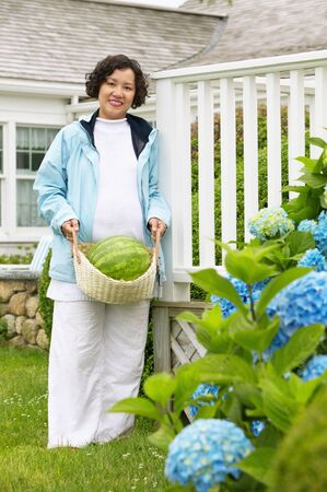 Portrait of a mid adult woman standing in a garden Stock Photo - 16044781
