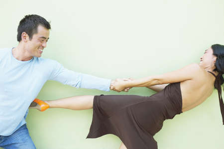joyousness: Young woman pulling a mid adult man by his arm