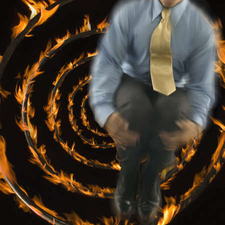 Concentric rings of fire with a businessman superimposed
