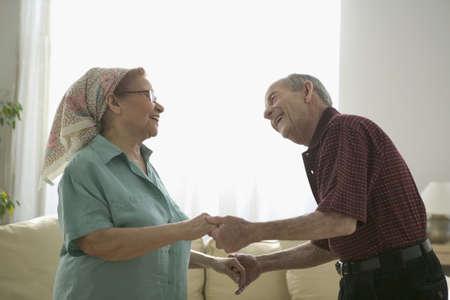 joyousness: Side profile of a senior couple dancing