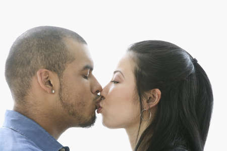two persons only: Side profile of a young couple kissing