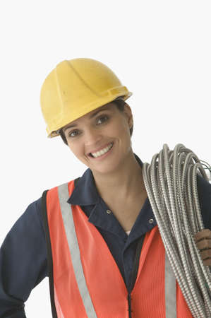 ebullient: Portrait of a mid adult woman holding steel cable