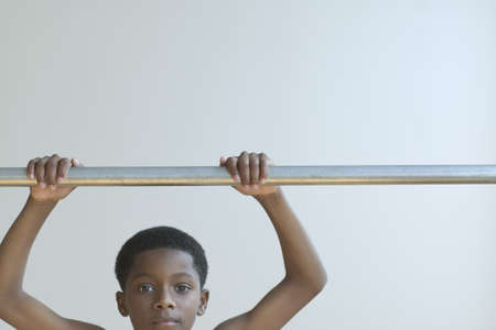hold ups: Young boy holding a push up bar