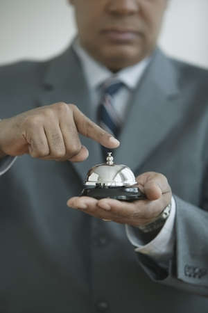 Mid section view of a senior man holding a desk bell Stock Photo - 16045039