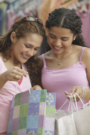 teenaged: Teenage girl shopping in a clothing store