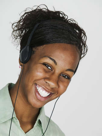 earphone: Portrait of a young woman wearing headphones smiling