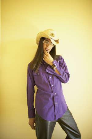 aplomb: Portrait of a young man with a cowboy hat LANG_EVOIMAGES