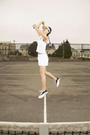 effrontery: Portrait of a young woman playing tennis on a tennis court
