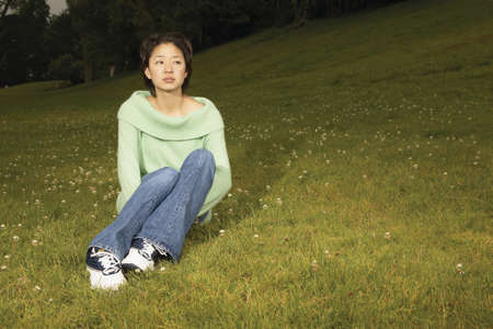 informant: Young woman sitting on grass