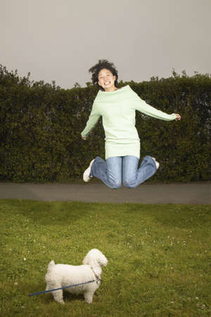 1 person: Young woman jumping in the air
