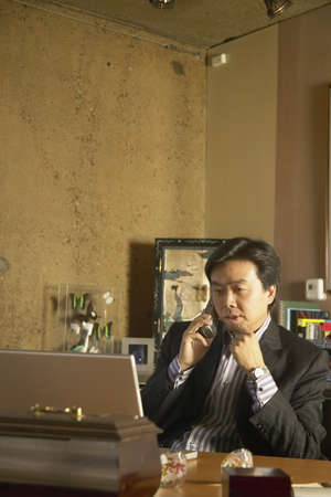 communicated: Businessman talking on a mobile phone