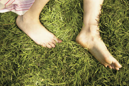 informant: View of a young womans feet on a lawn