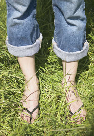 blase: Young woman standing on grass LANG_EVOIMAGES