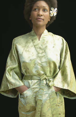 airs: Portrait of a young woman standing wearing a robe