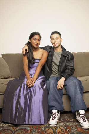 indolence: Portrait of a teenage couple sitting on a couch LANG_EVOIMAGES