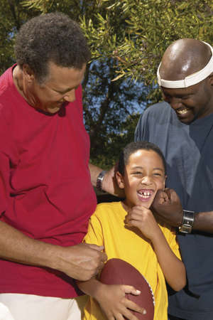 Mid adult men with playing with a young boy Stock Photo - 16045240