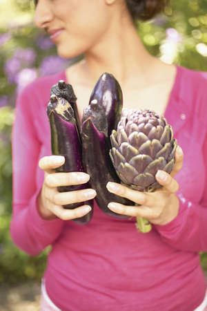 Woman holding vegetables in a garden Stock Photo - 16045241