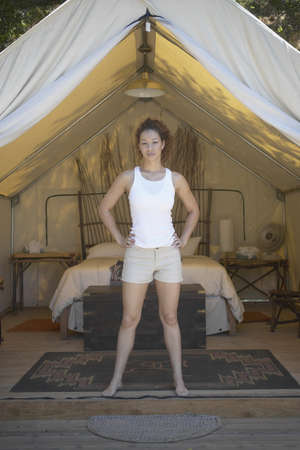 panache: Portrait of a young woman standing in front of a tent LANG_EVOIMAGES