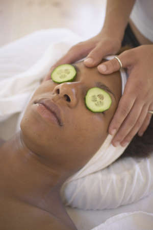 treatment: Young woman getting a facial treatment in a health clinic