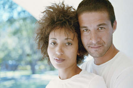 Portrait of a couple standing together looking at camera Stock Photo - 16045323