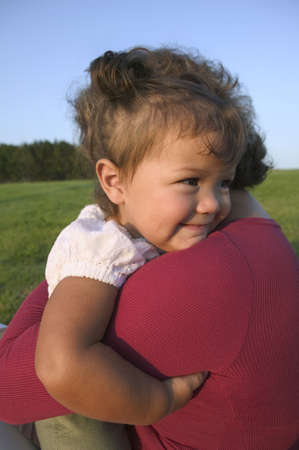 Mid adult woman holding a baby girl LANG_EVOIMAGES