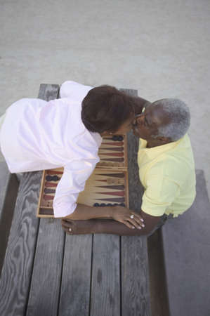 two persons only: High angle view of a mature couple sitting together kissing over a table LANG_EVOIMAGES