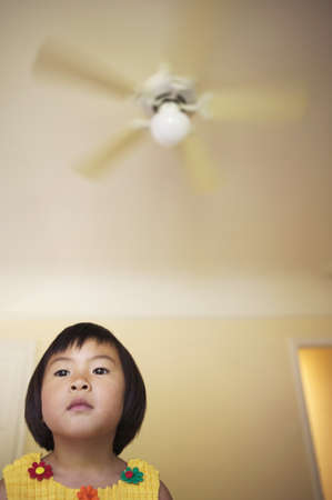 nosey: Low angle view of a young girl looking ahead LANG_EVOIMAGES