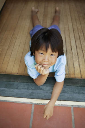 Portrait of a young boy lying on the floor Stock Photo - 16045369