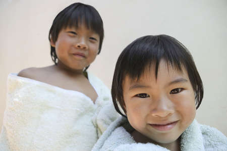 two persons only: Portrait of two children wrapped in a towel