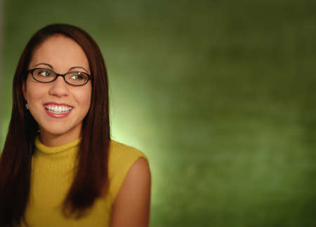 magnificence: Mid adult woman smiling wearing eye glasses LANG_EVOIMAGES