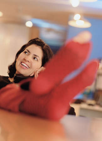 Woman talking on the telephone with focus on her feet Stock Photo - 16045395