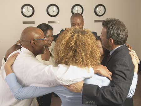 confab: Group of business executives in a huddle