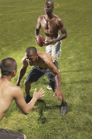 exactitude: Three young men playing football