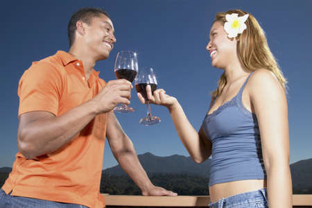 anecdote: Young couple toasting with red wine