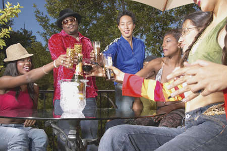 ebullient: Group of young people toasting at an outdoor party LANG_EVOIMAGES