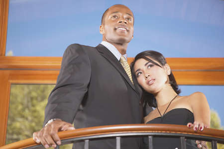 Young couple standing on a balcony Stock Photo - 16045498
