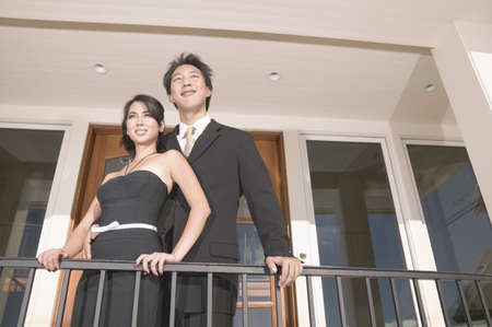 balcony: Young couple standing together on a balcony