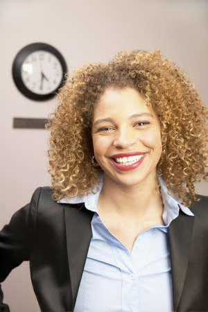 african american ethnicity: Young businesswoman looking at camera smiling LANG_EVOIMAGES