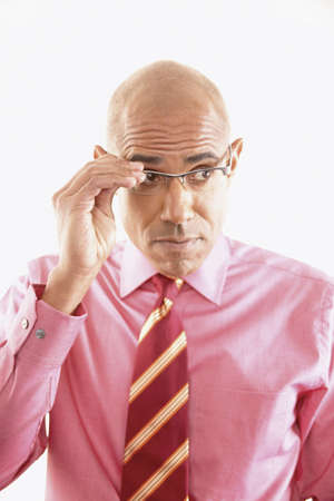 Portrait of a businessman adjusting his eye glasses Stock Photo - 16045533