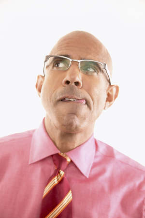 skepticism: Portrait of a businessman making a face LANG_EVOIMAGES